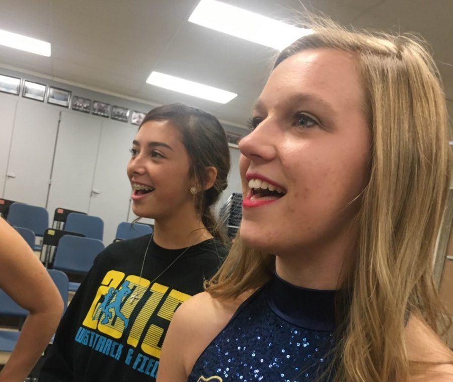 Cassie Bradshaw and Iralyn Carmona sing during choir class on Friday.