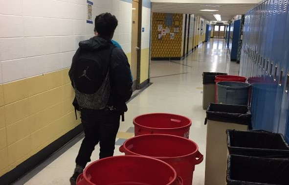 A Greeley West student walks to class during third period down the 600 hallway two years ago, dodging trash cans as he goes.  This won't be a problem for future Spartans after the community passed Bond Issue 4C on Tuesday night.