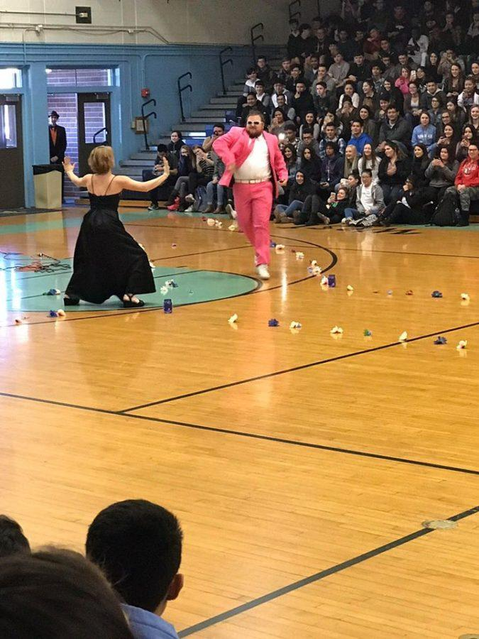 Mr. Chuck Wolfe and Ms. Mariana Poling dance in front of the school at the Prom Fashion Show.
