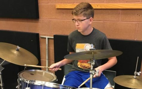 Student shows passion for jazz behind drum kit