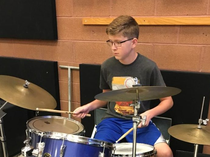 Freshman Evan DeMeyer plays the drums during jazz band class this week.