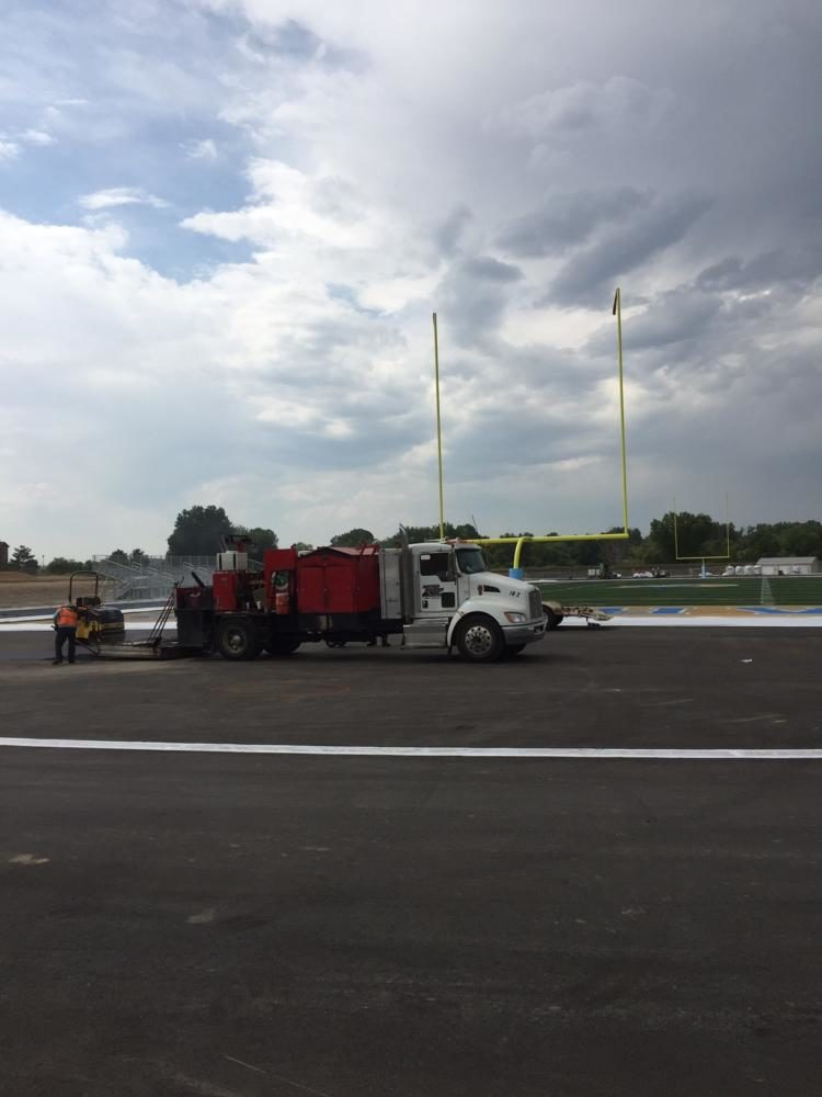 A+maintenance+truck+is+parked+next+to+the+new+football+field+and+track.++The+project+will+be+finished+on+September+18.