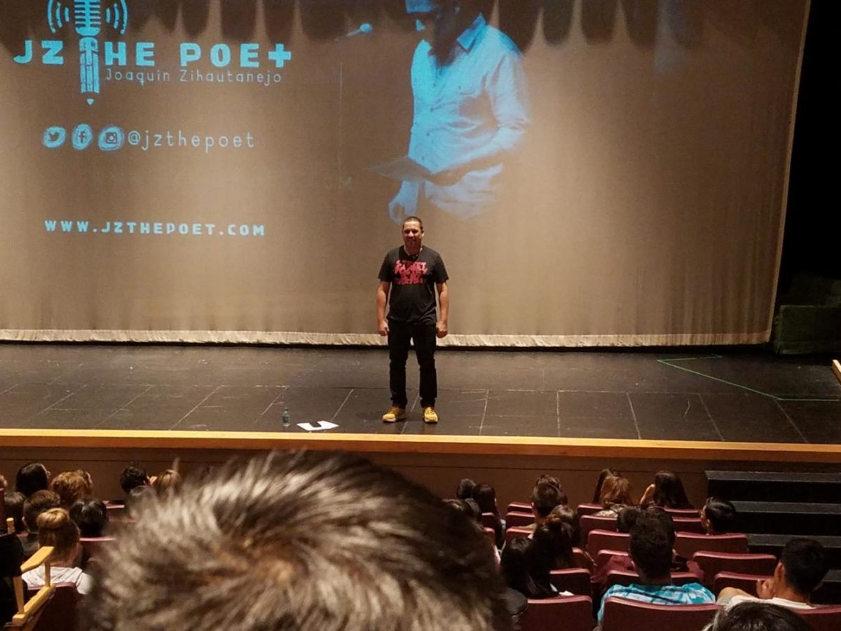 World Champion slam poet Joaquin Zihuatanejo shares his story in the Greeley West auditorium on Friday afternoon.