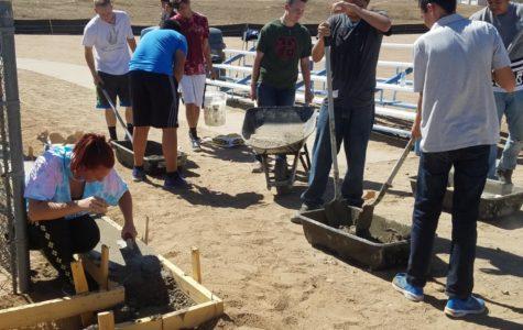 Construction trades class begins dugout project for softball team