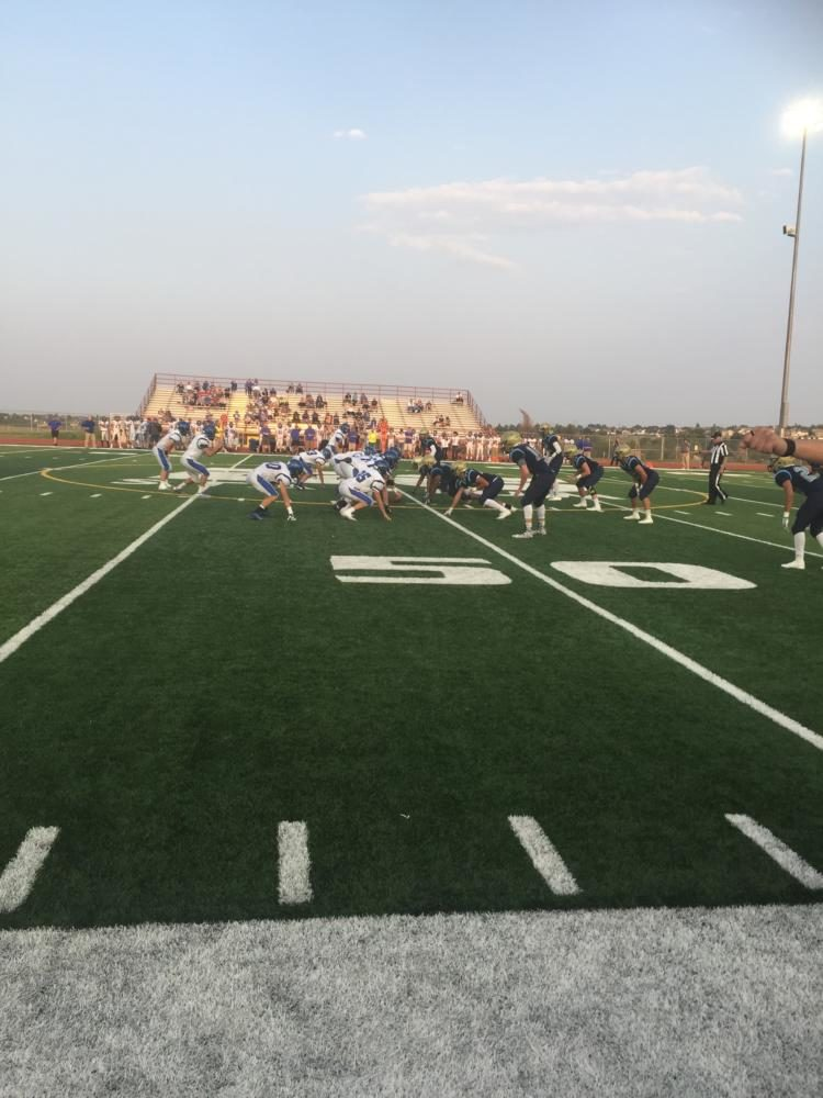 The+football+team+lines+up+on+defense+during+its+game+against+Longmont+last+week.