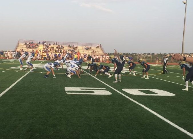 The football team lines up on defense during its game against Longmont last week.