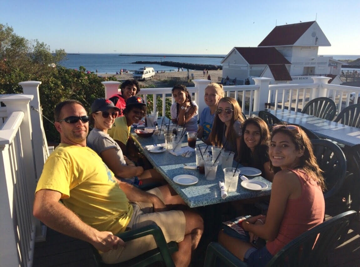The Greeley West girls cross country team sits at dinner along the beach on their recent trip to Rhode Island for an invitational.