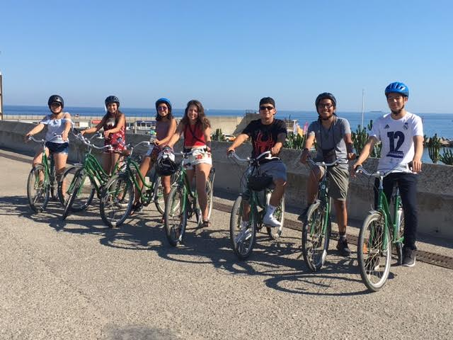 Students+pose+for+a+picture+during+their+bicycling+trip+through+Barcelona%2C+Spain+this+summer.+