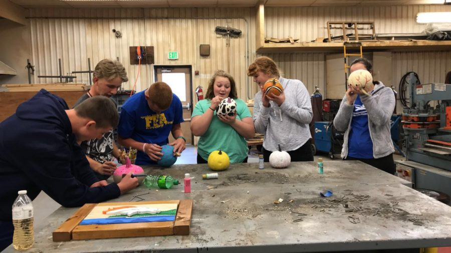 FFA students decorate pumpkins as a community service project.