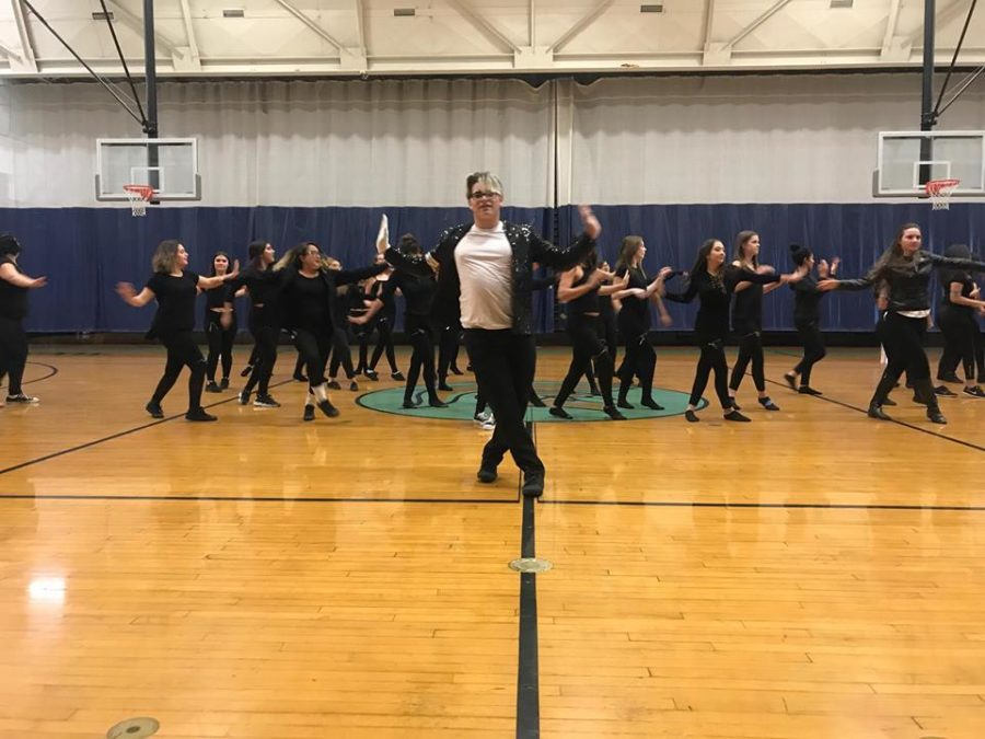 """Enmanuel Rodriguez leads the dance class in its interpretation of """"Thriller"""" on Thursday."""