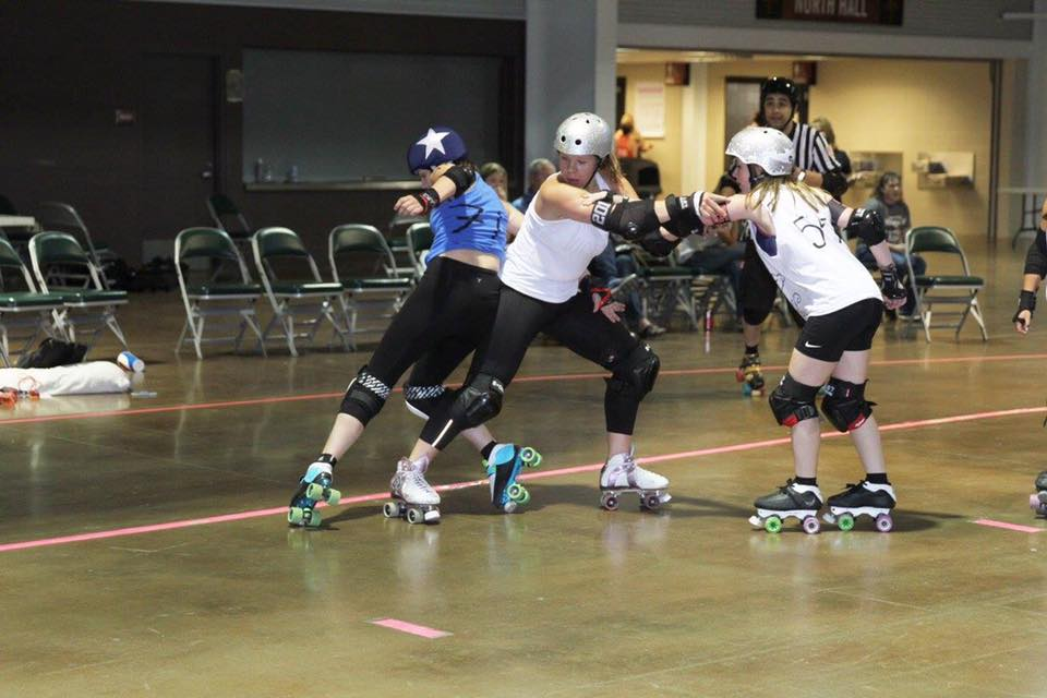 Junior Ashley Adamson blocks an opponent during a roller derby practice. (Photo courtesy of Ashley Adams)