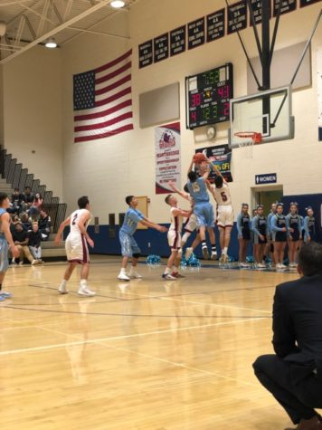 Boys basketball move into second round after energetic win over Brighton