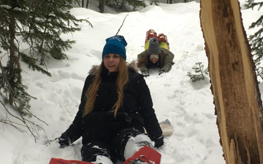 Jennifer Sample front) and Michelle Lopez) slide down a snow slide during the AP Environmental Science field trip to Estes Park.