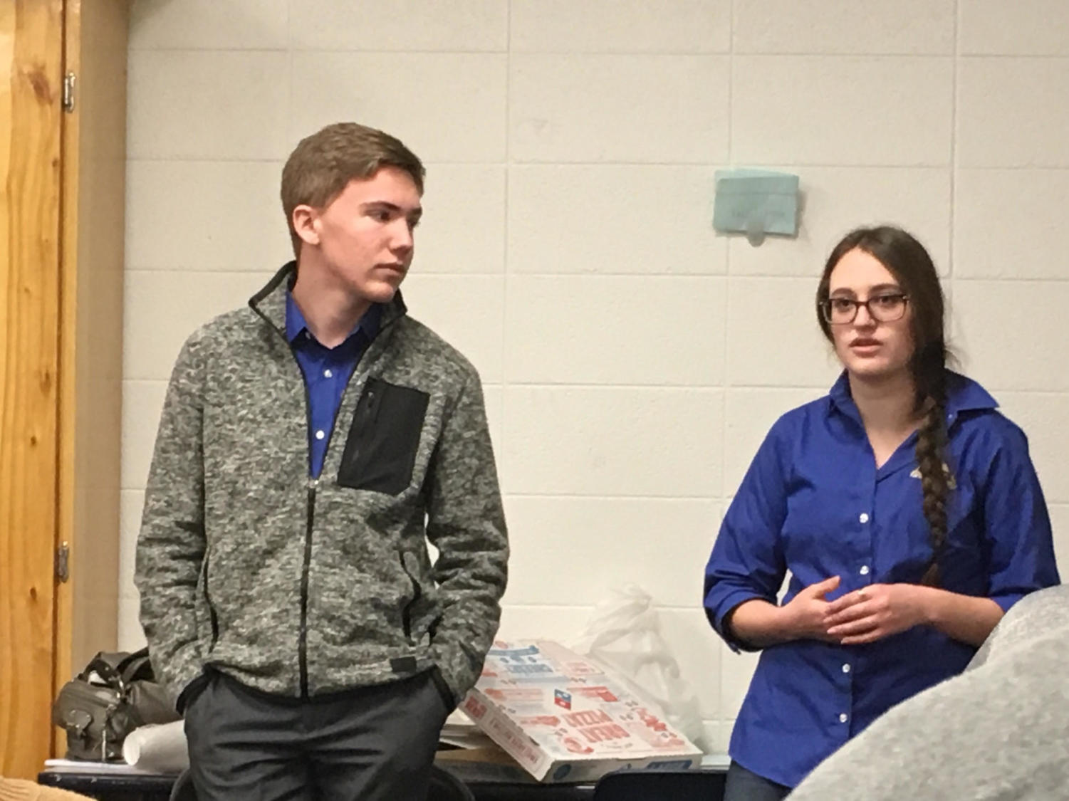 Seniors Spencer Evans and Megan Arscott lead a meeting at Greeley West with potential Junior Board of Trustees students on Tuesday at lunch.