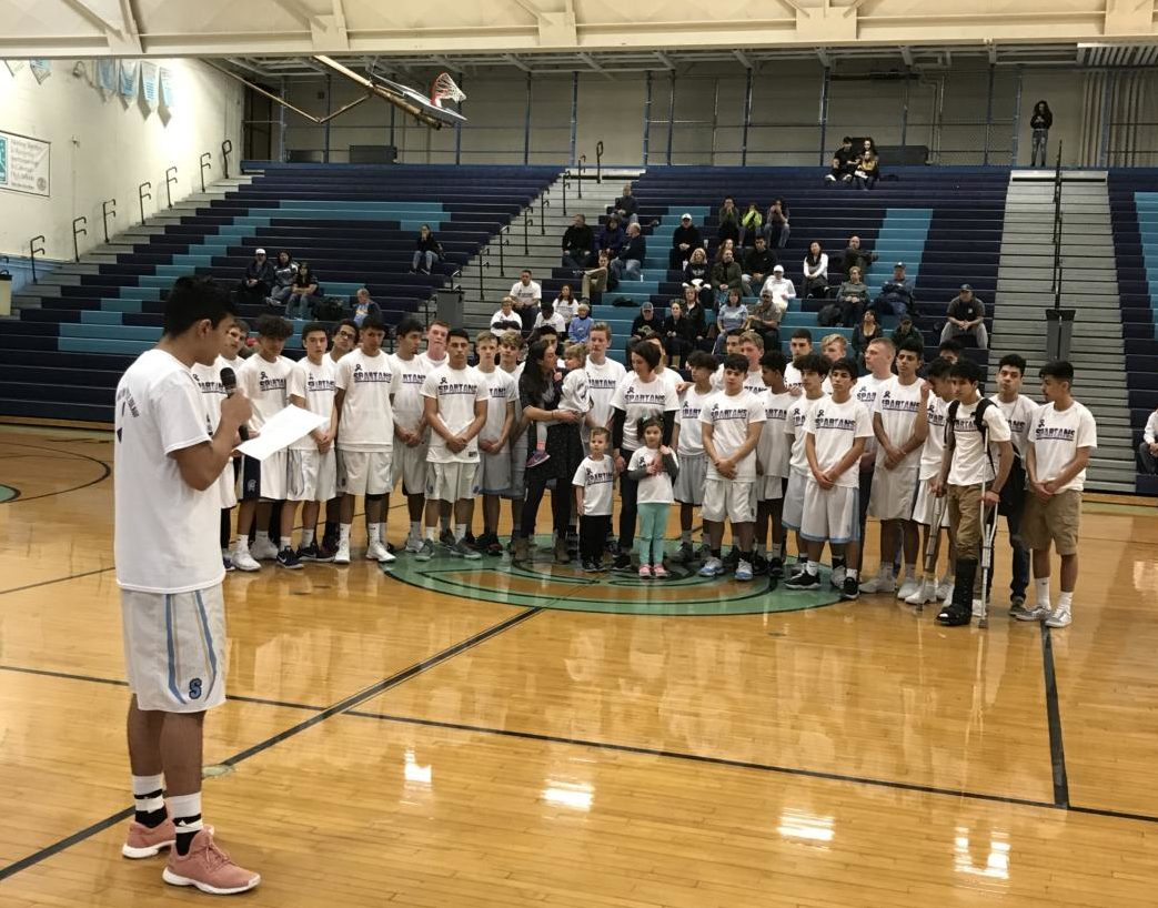 Senior basketball player Oscar Flores reads a statement explaining the need for Purple Nights supporting the Zulauf family.