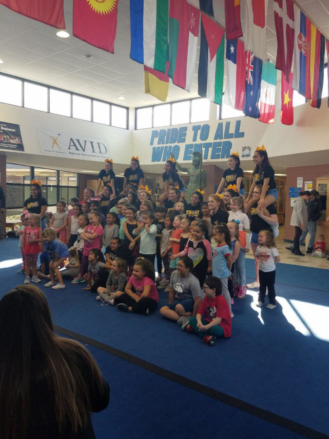 Cheerleaders+pose+with+their+participants+at+their+annual+cheer+clinic.