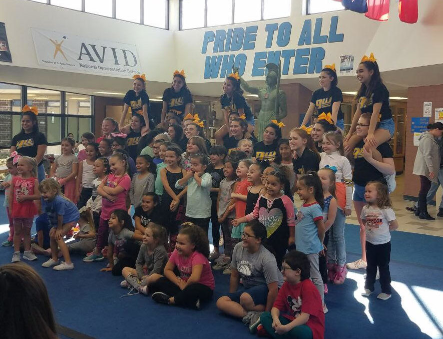 Cheerleaders pose with their participants at their annual cheer clinic.