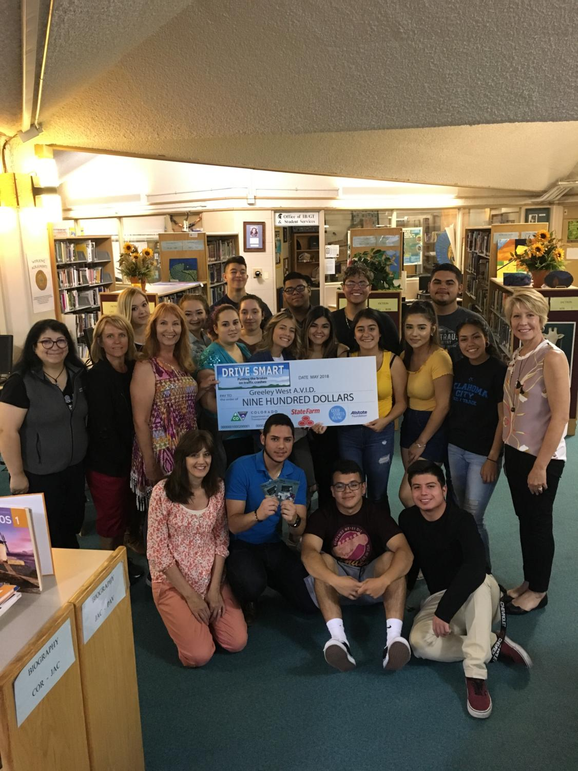 Greeley West AVID seniors were presented money from Drive Safe for their efforts this school year.