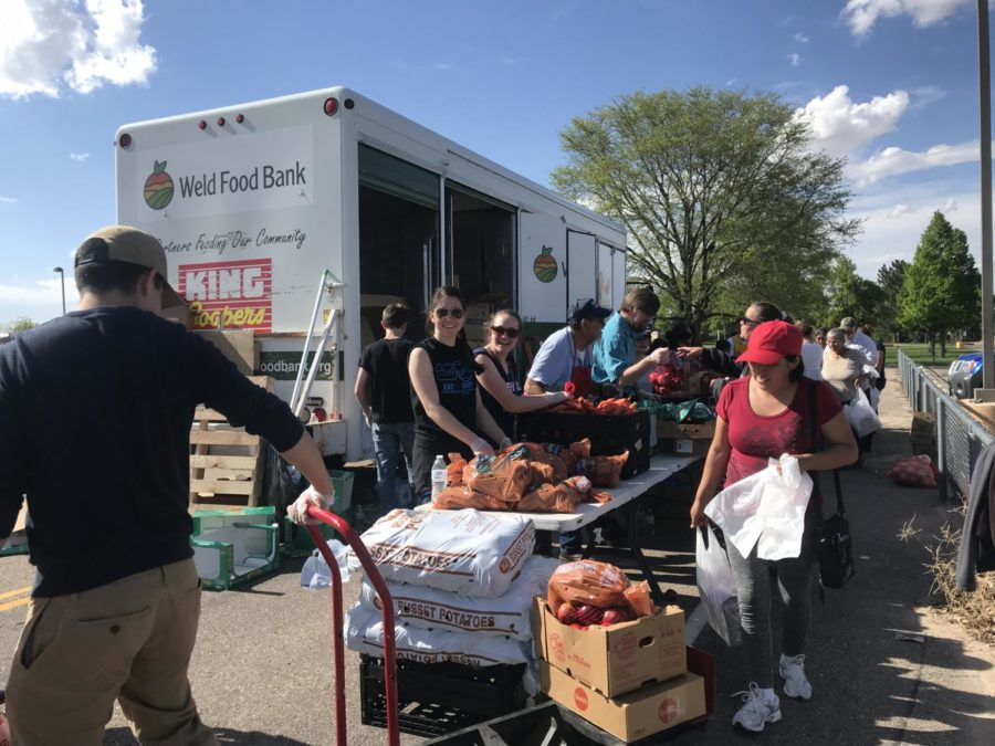The+Greeley+West+Key+Club+partnered+with+the+Weld+County+Food+Bank+to+distribute+food+at+school+last+week.+