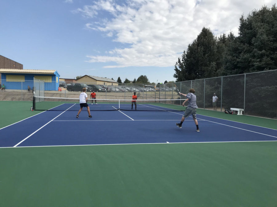 Brayden Startzer, right, is making an impact as a player on the Greeley West tennis team, despite having never played before.