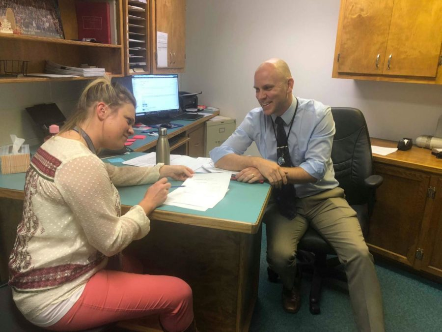 New Assistant Principal Mr. Aaron Allen works with Ms. Hannah Webster in his office.  Allen is excited for the school year after his first two weeks.