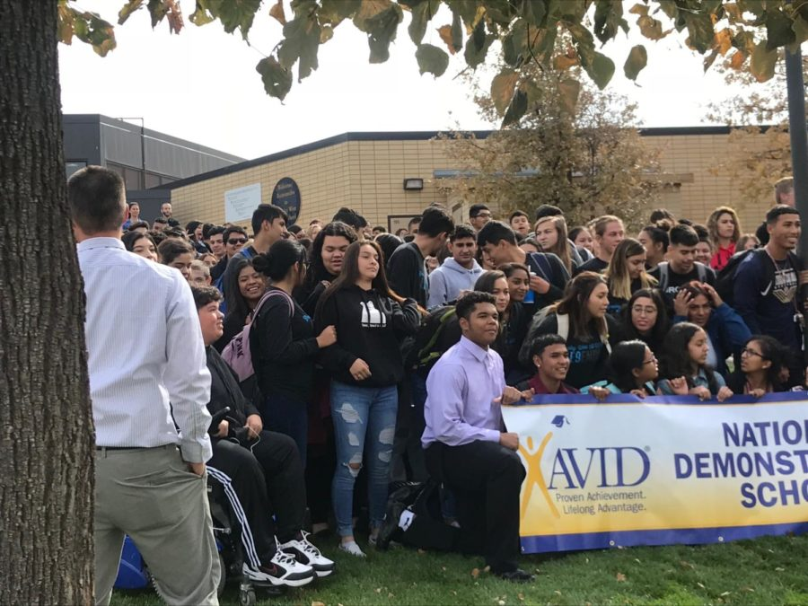 Greeley West principal Mr. Jeff Cranson works to organize AVID students for a picture after it was announced that the school maintained its Demonstration School status.