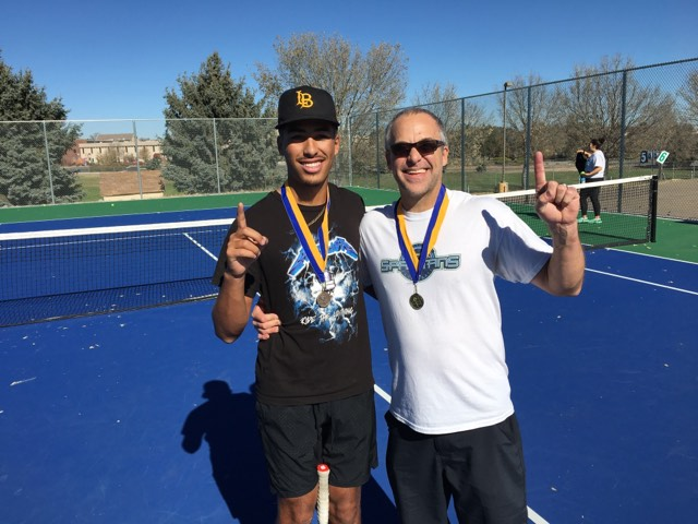 The Torrezs celebrate their victory at the Facaulty-Player Tennis Tournament.