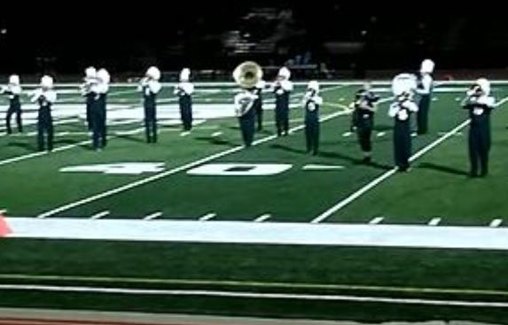 Greeley West's marching band performs during during a Friday night football game last year.