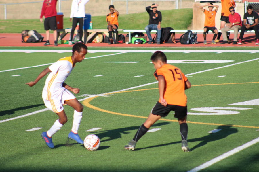 Greeley+West+senior+Salman+Hassan+dribbles+the+ball+at+midfield+during+Tuesday+night%27s+soccer+game+at+District+6+Stadium.++Central+beat+the+Spartans%2C+2-0.+