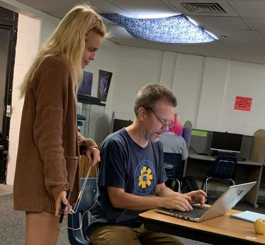 Mr. Colin Shaha helps senior Sydney Mathiot in the credit recovery lab earlier this week.