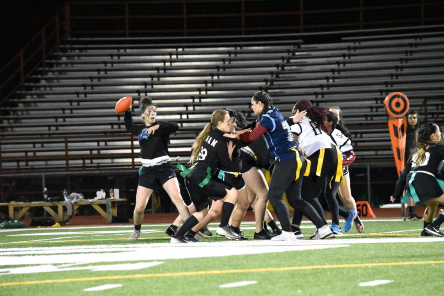 Greeley+West+powderpuff+players+from+2017+mix+it+up+during+their+game.