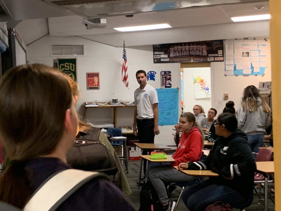 Mr.+Stephen+Paulson+greets+students+as+they+walk+into+his+classroom+on+Thursday.