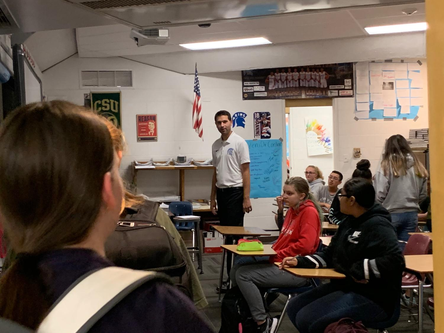 Mr. Stephen Paulson greets students as they walk into his classroom on Thursday.