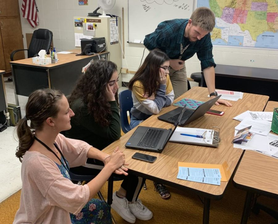 Mr. Mitch Staut and Ms. Olivia Marks help students Aidee Palma and Nataly Lopez-Salinas with their homework during their off block in the Futures Center on Tuesday.