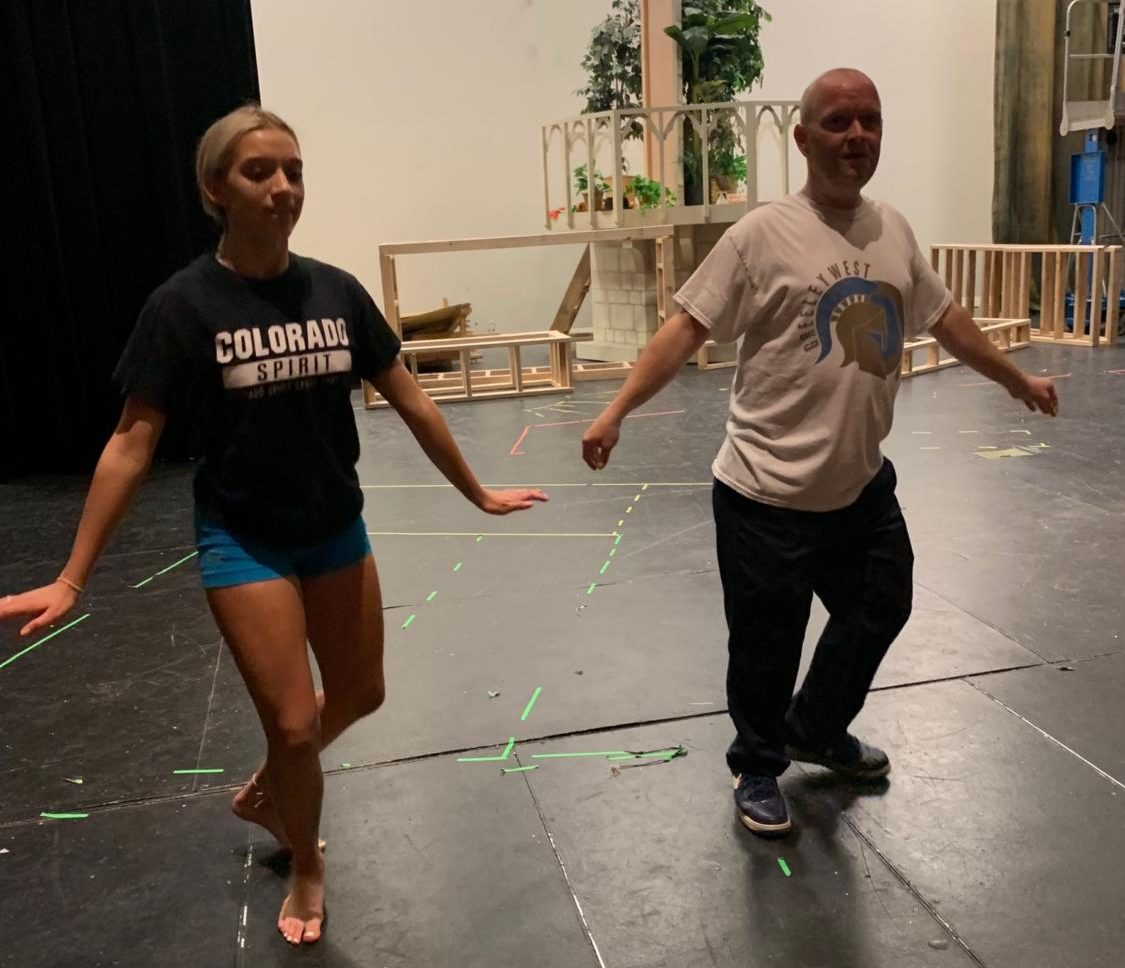 Junior Pom Chloe Job works through her routine with Mr. Troy Jarrell  for Saturday nights Dancing with the Teachers show.