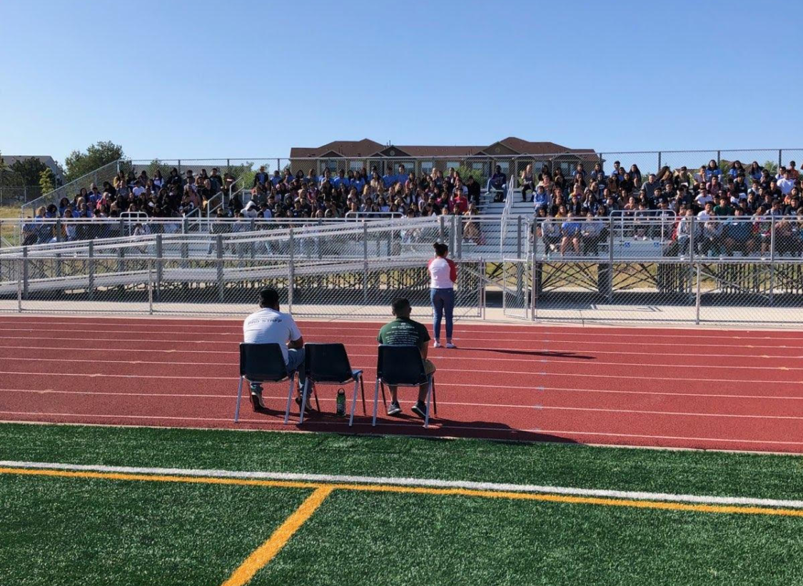 Greeley West AVID students sit on the bleachers on the football field listening to guest speaker Ivanna Rizo share stories about college and how AVID helped her get there.