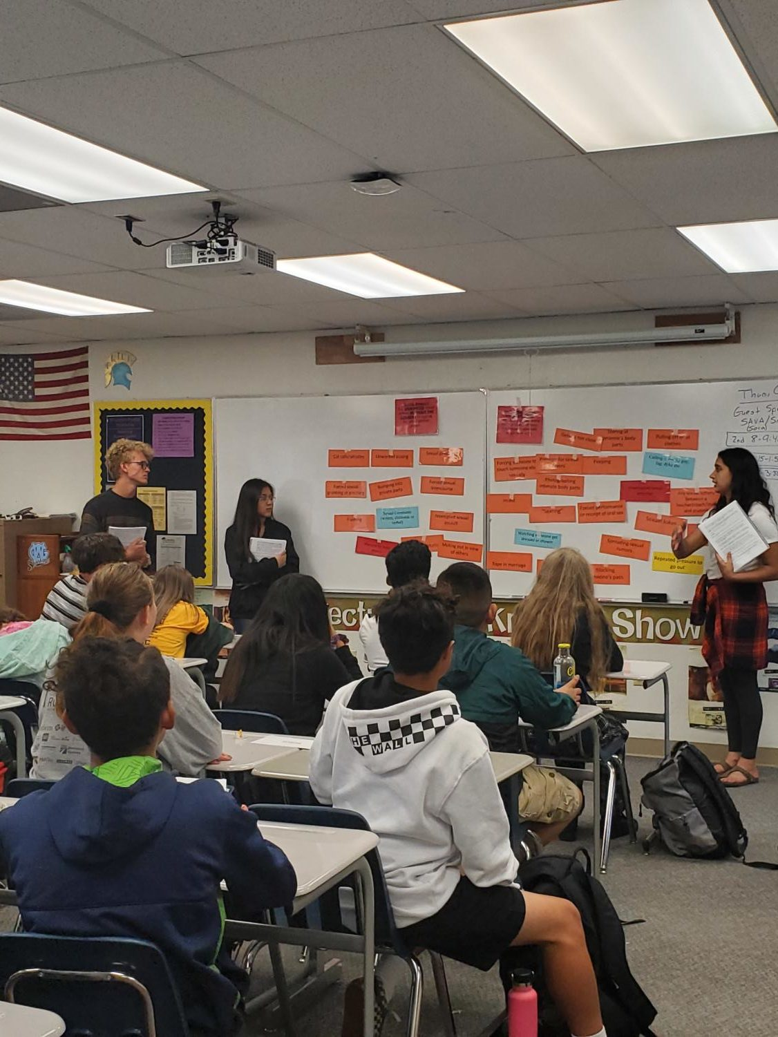 Brendan McCune, Monique Benavidez, and Grace Chahal work to end sexual assault in Mr. Brian Holmes health class on Thursday.
