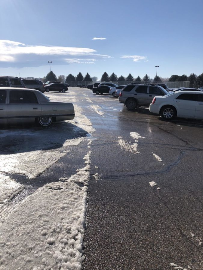 Cars are parked out of wack in the north lot after snow fell and covered up the parking spaces.  West students thought they deserved a day off for the snow earlier this week.