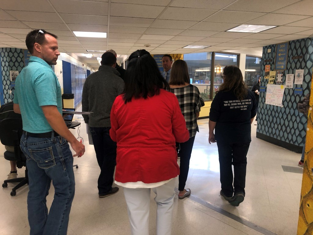 Principal Mr. Jeff Cranson leads a community tour in the commons this week.  There have been a lot of tours happening around Greeley West as the election nears.