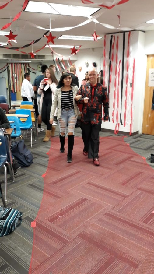 Mr. Troy Jarrell guides Melanie Zambrano Lopez down the red carpet for his project during Dramatic Lit on Friday, October 25.