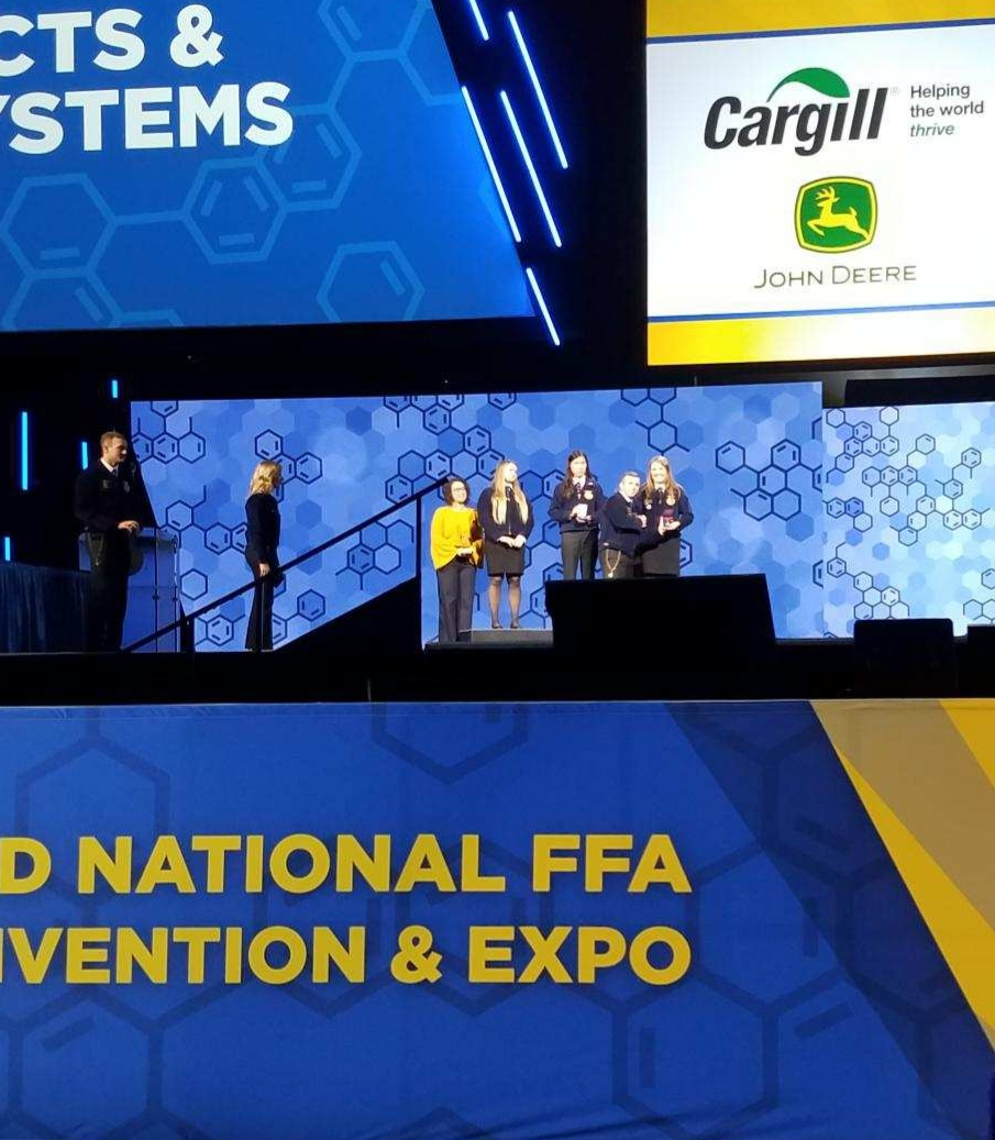 Kathryn Broderius is presented her reward in Lucas Oil Stadium in Indianapolis, Indiana at the FFA National Convention.  She may look like dot in this picture, but the venue holds 75,000 people and this was as close as we could get.