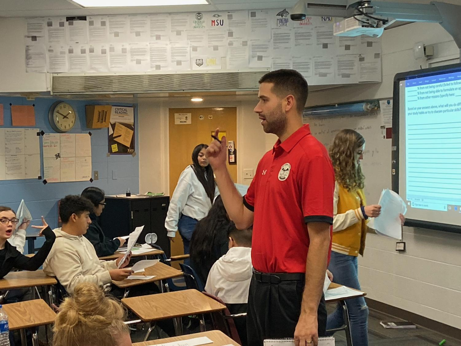 Mr. Stephen Paulson teaches his AP Human Geography class on Thursday behind his bushy beard.  Paulson started the No Shave November competition on November 1 and now bares no resemblance to the clean-shaven, handsome man he used to be.