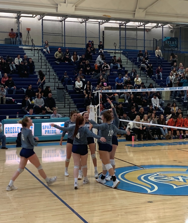 The+Greeley+West+volleyball+team+celebrates+a+point+against+Greeley+Central+earlier+this+season.