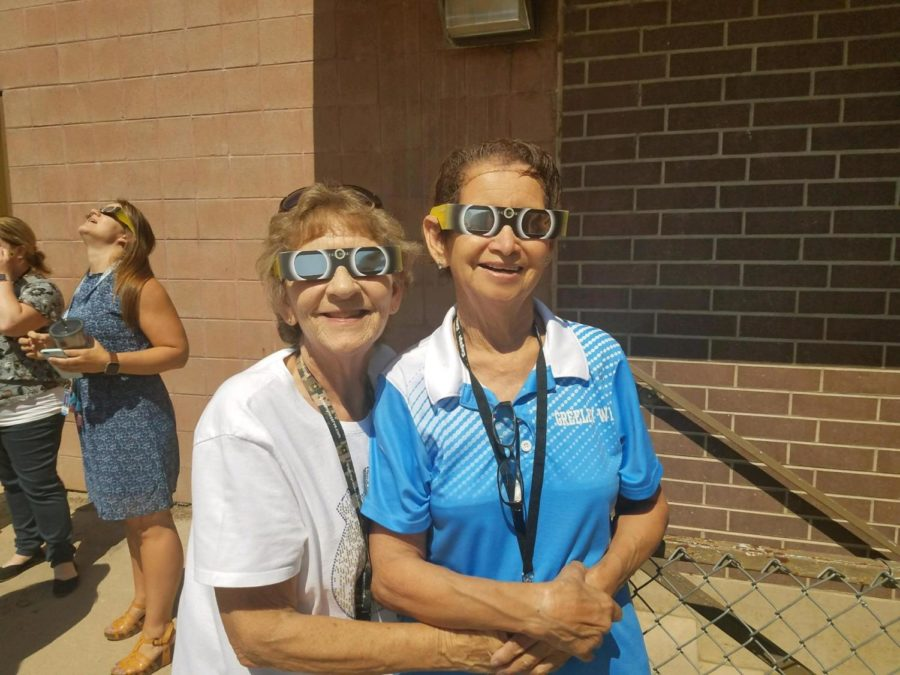 Greeley West staff members Ms. Alice Weidenkeller (left) and Ms. Sophie Rogers celebrate an eclipse at Greeley West a few years back.  Greeley West paused on Monday to celebrate Weidenkeller's life after she passed away unexpectedly last weekend.