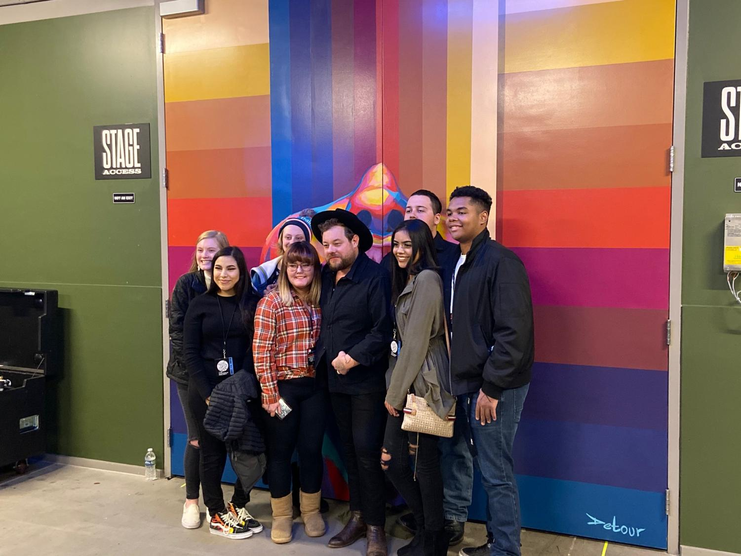 Greeley West orchestra students and their guests pose for a picture with musician Nathaniel Rateliff before his concert at Mission Ballroom last week.