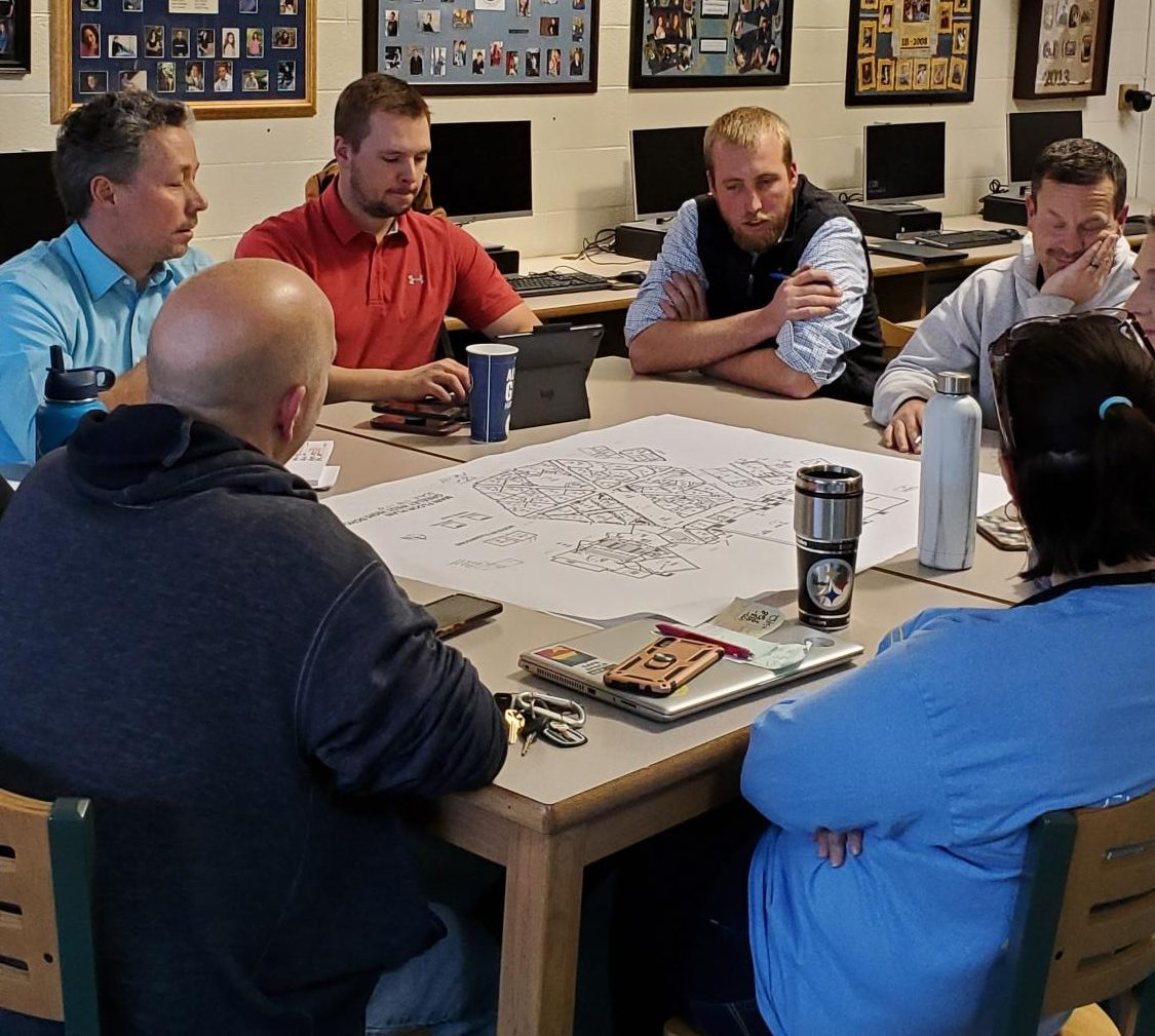 Matt Pota, left, and Austin Mouw from Hord Coplan Macht and Adolf and Peterson, respectively, meet with Greeley West faculty members about new school designs on Friday.