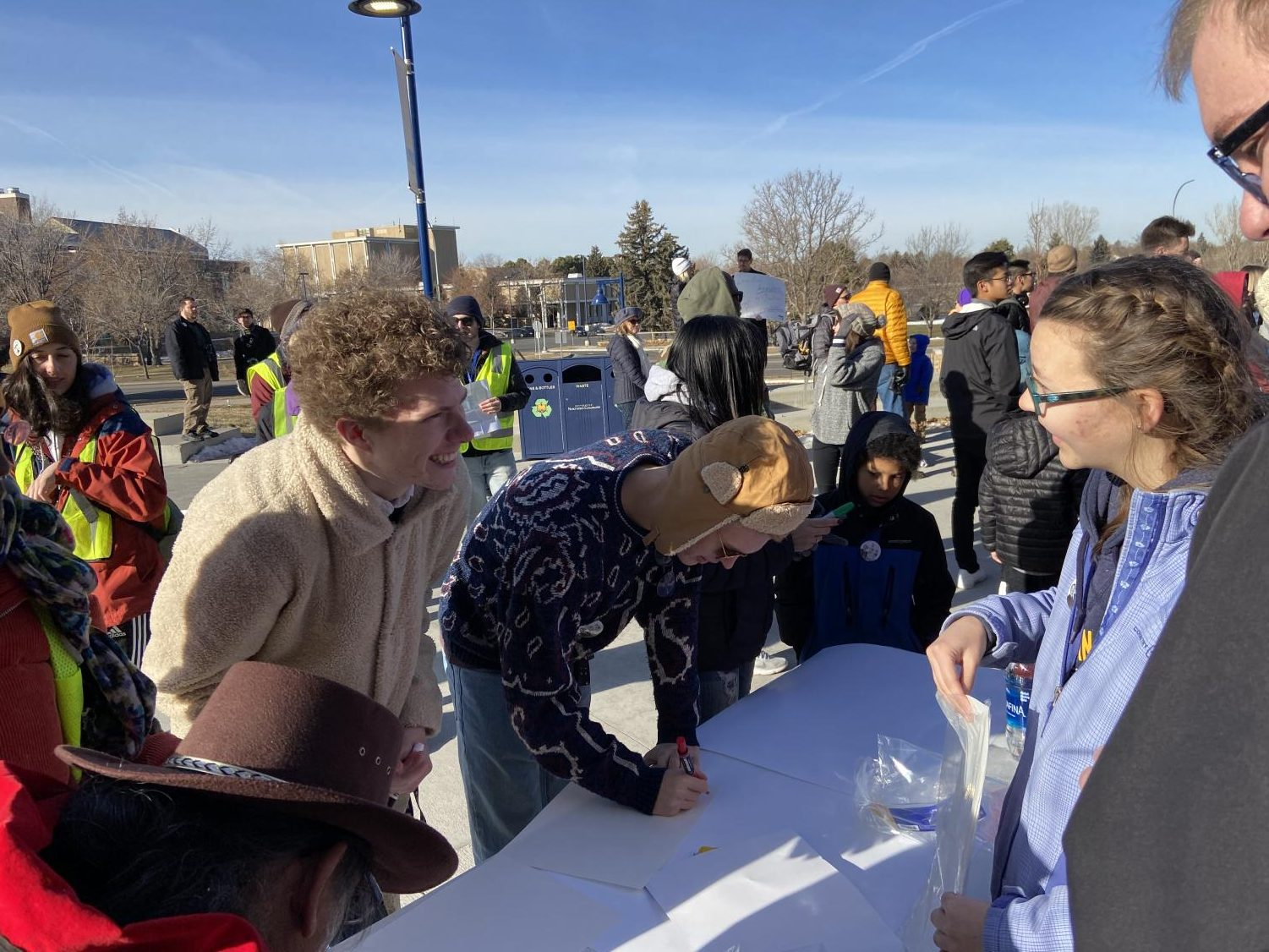 Jacob Evans and Brendan McCune make signs before the Martin Luther King march on Monday at the University of Northern Colorado.
