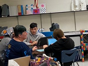 Ms. Patricia Knepper instructs students on Friday in her classroom.  Knepper shares her room through the day which is an added stress to teaching at Greeley West.