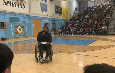Motivational speaker Timothy Alexander addresses the student body during an all-school assembly on Thursday.