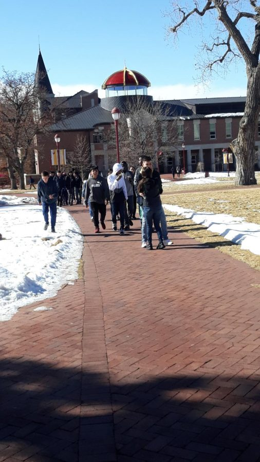 Students head back to the bus after visiting the University of Denver.